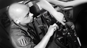 Geek agent installing car stereo