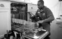 Geek Squad Agent repairing dishwasher