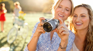 Women with digital camera
